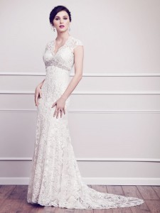 Bridal gowns - LGM65 -V-neck sheath dress with Venice lace and a beaded arch by Kenneth Winston.